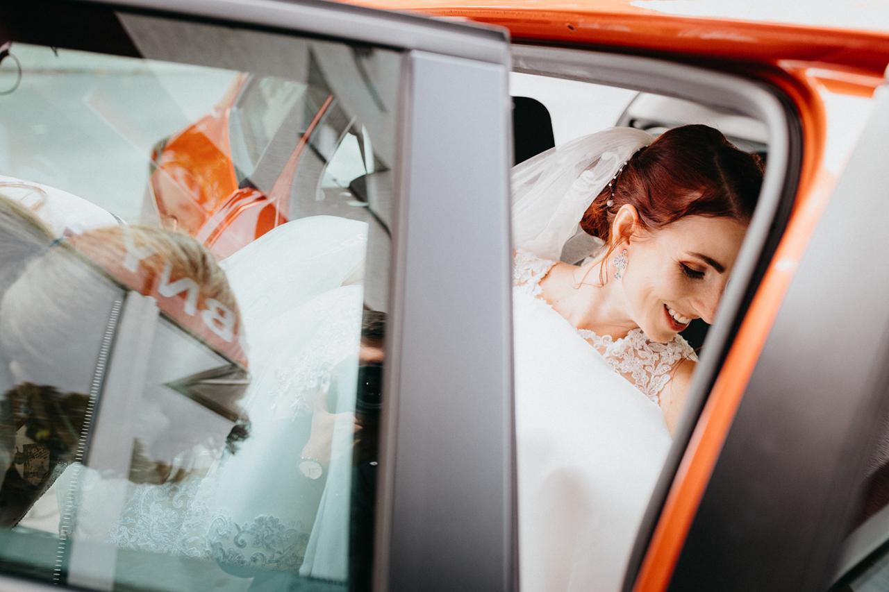 Image may contain: car, human face and wedding dress