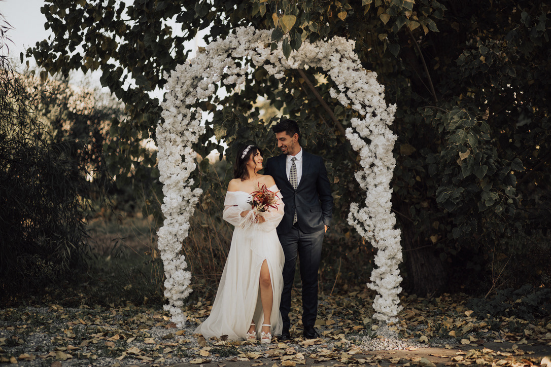 Image may contain: tree, wedding dress and outdoor
